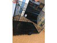 Large dog cage, only used once.