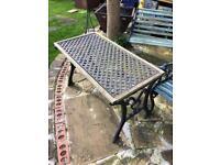 Heavy oak & cast iron garden table needs a little tlc