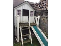 Gorgeous wooden playhouse with slide needs some tlc but very sweet