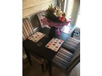 Black wooden table with 4 fabric chairs