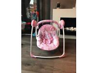 Pink baby swing