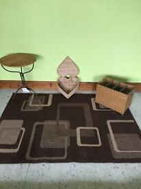 Brown rug with wicker items