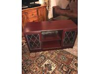 TV Unit & 2 small glass top tables.