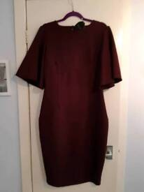 Size 16 dress. Still has tags on. Mulled wine colour