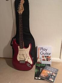 Red Fender Squier Strato Guitar and accessories. Great Christmas present.