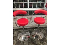 Two Red and Chrome Bar Stools