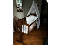 Cambridge swinging crib and winnie the pooh bedding set walnut dark wood