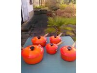 Le Crueset set of 5 vintage saucepans. Volcanic orange. 14,16,18,20,22 cms. Good condition.