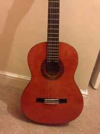 Acoustic Guitar for sale- includes case.