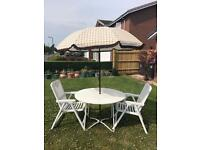 Wooden Patio Table, Vintage Umbrella and Two White Chairs