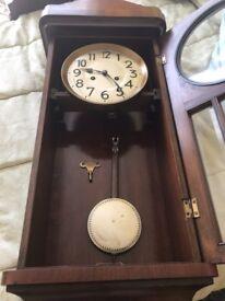 Antique wooden pendulum wall clocl