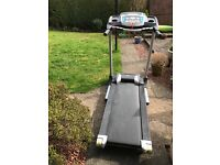 Treadmill running machine by Roger Black. Folds up when not in use.