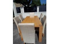 Light oak table with six leather chairs good condition