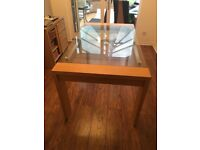 Dining room table. Wooden legs with glass top. Good Condition.