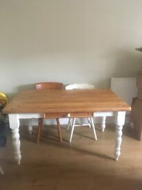 Distressed cream solid wooden table