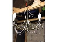 2 Chandelier ceiling lights, each with 3 candle bulbs.