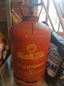 She'll gas 11kg propane, empty.