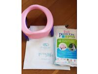Travel potty + toilet trainer seat