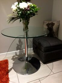 Circular glass and chrome table.Great condition.