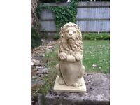 A pair of lions with shields £30