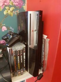 Ps3 80gb and 5 games