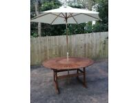 Patio table, lazy susan, parasol, brand new , free local delivery.