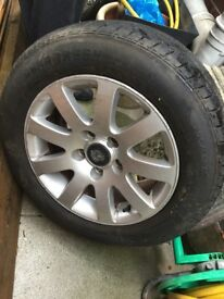 "4 15"" vw alloy wheels and 1 spare"
