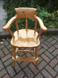 Beautiful solid wood high chair with painted and varnished detail.