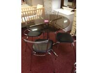 Black glass table with 4 chairs