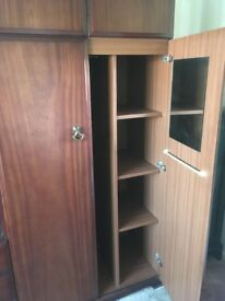 Two wardrobes with overhead cupboard and middle section with cupboard and drawers