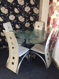 SOLD!!!! Tempered glass table and 4 chairs