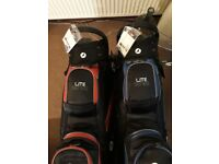 3 - 2 blue/1 red - Motocaddy lite series cart bags.