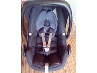 Maxi Cosi Peeble car seat and infant hugger.
