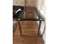 Glass and black dining table with chrome legs