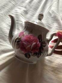Collection of tea sets, tea pots, cake stands and more