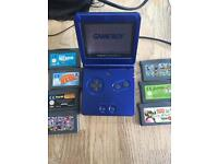 Game boy advance SP with charger, games and holder
