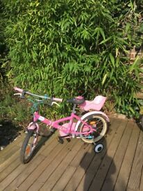 Great condition b'Twin pink bike with stabilisers