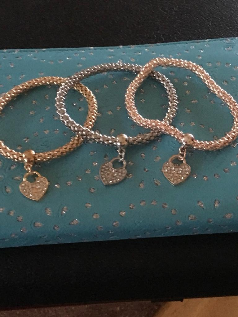 Ladies 18ct gold bracelets with a rhinestone heart charm set of 3 new