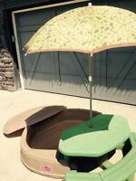 Sandbox with picnic table and umbrella