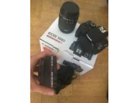 New Canon 100d SLR with extra wide lens + 3 batteries, 2 chargers...