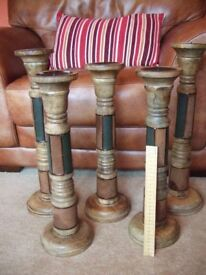 Five x large Indian wood candle sticks / holders with faux leather decoration £7 each £30 The Lot
