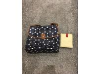 Navy and white Babymel changing bag with changing mat