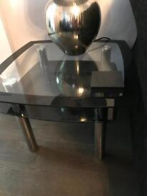 Glass table with chrome legs