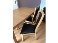Oak style extendble dining table & 4 brown faux leather chairs @ 12 months old great condition