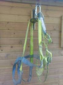 Pair of safety harness with energy absorbing lanyards...