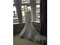Beautiful appliqué lace wedding dress