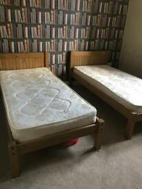 2x single pine beds with mattresses
