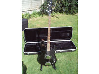 Black bass guitar by Samick with Fender accessories and solid Gator case