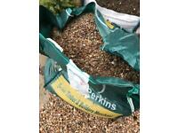 FREE** 1/2 Tonne bag of 20mm gravel - Travis Perkins