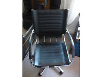 Faux black leather and chrome swivel chair